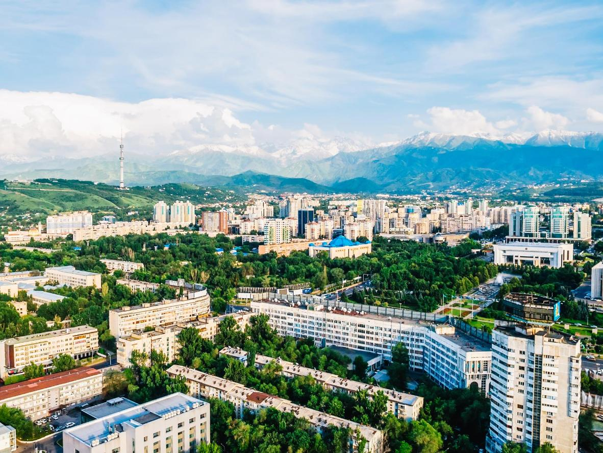The snow-capped Trans-Ili Alatau mountains form the backdrop in Almaty