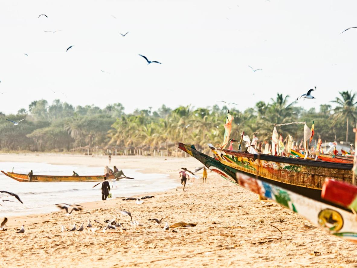 Senegalese and Gambian fishing boats moored on the sand