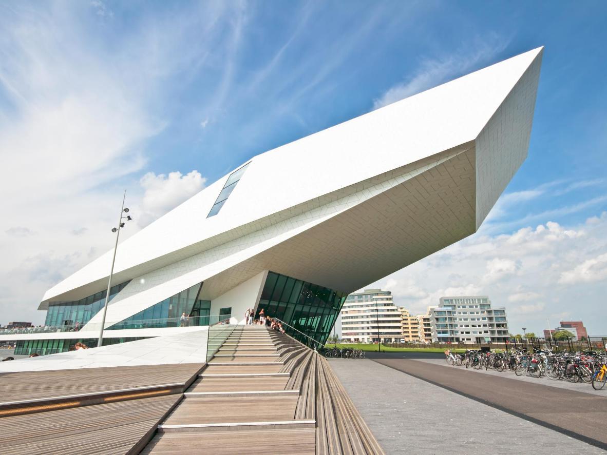 A futuristic cinema perched on the river Ij