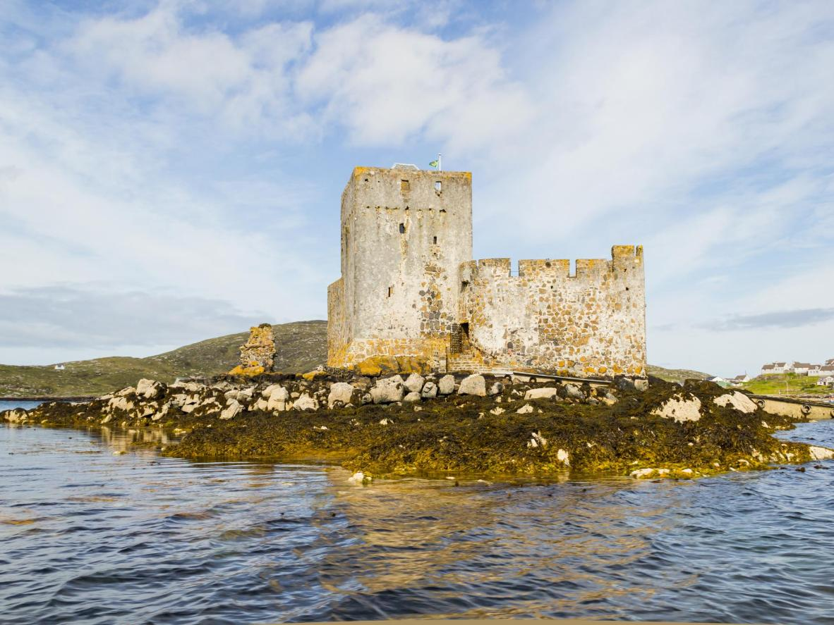 Kisimul Castle, a small medieval castle located on an islet in the centre of Barra's Castlebay