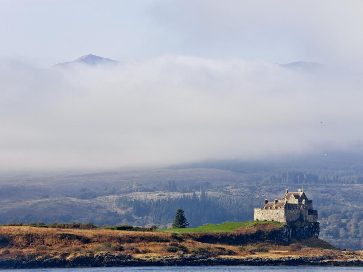 Duart Castle (the ancestral home of Clan MacLean) as the morning fog lifts from the mountains of Mull