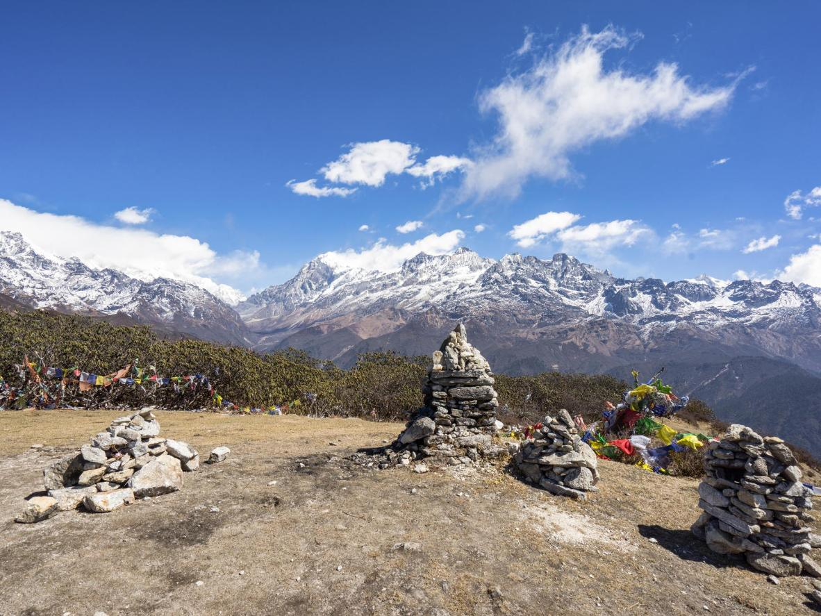 Buddhist rock piles and prayer flags decorate the Himalayas in Sikkim