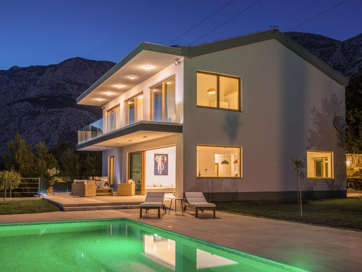 Enjoy this villa's views of greenery, blue ocean and the town of Tučepi's charming harbour on Croatia's Adriatic Coast