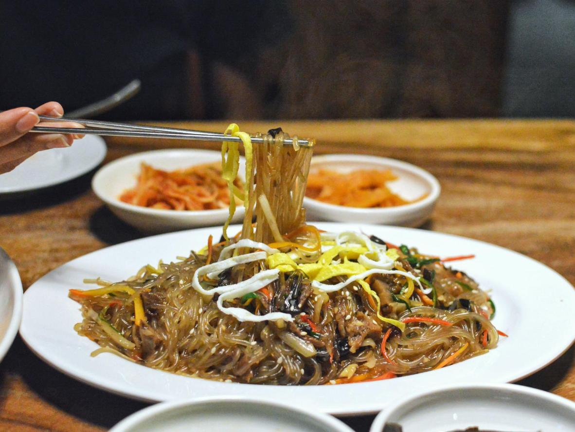 Japchae is served cold and popular during a hot Korean summer