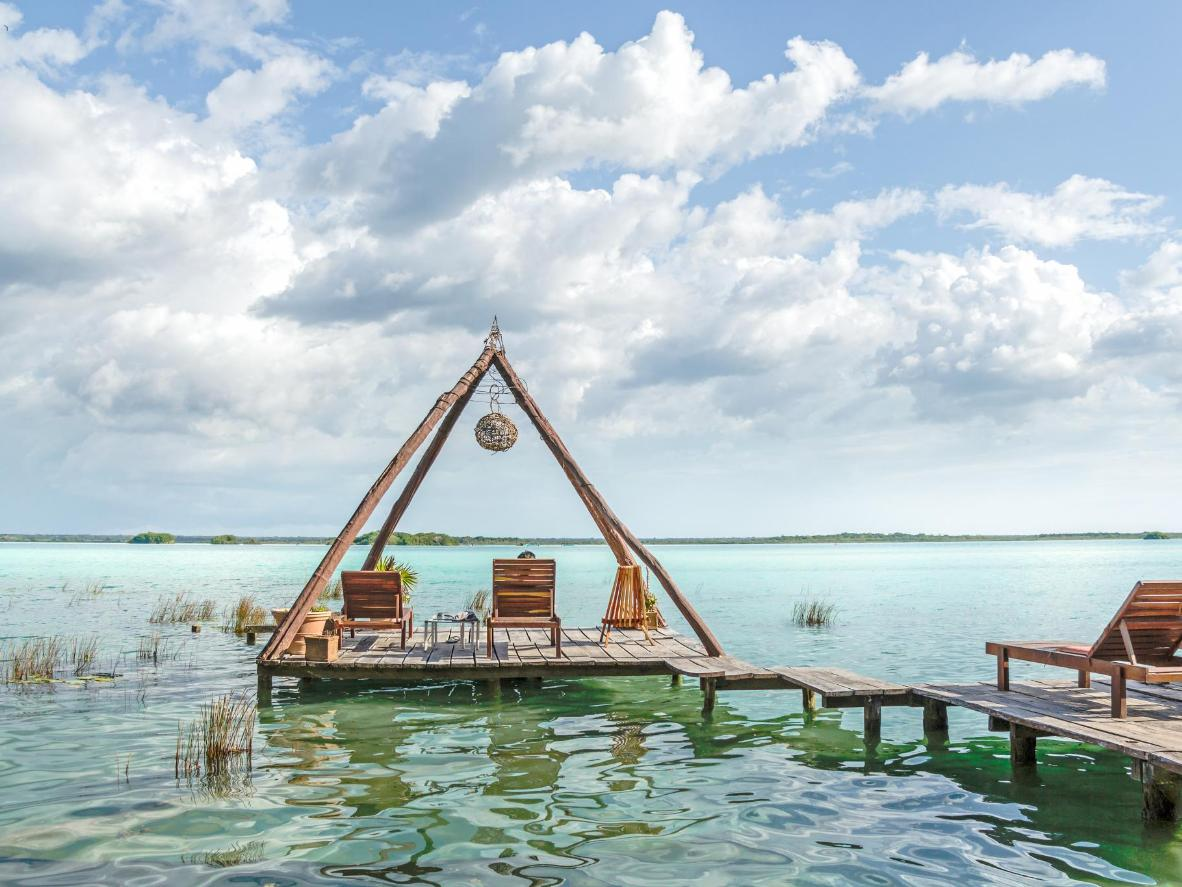 Bacalar is famous for its 'Lake of Seven Colours', bordered by mangroves and fishermen's houses