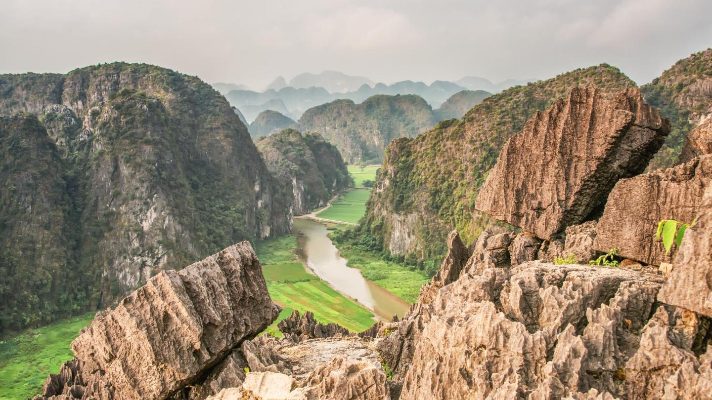 Take in the view of Tam Coc Valley from the top of Moa cave