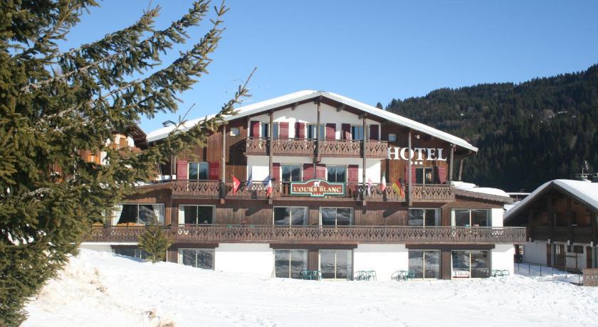 白色承担木屋酒店