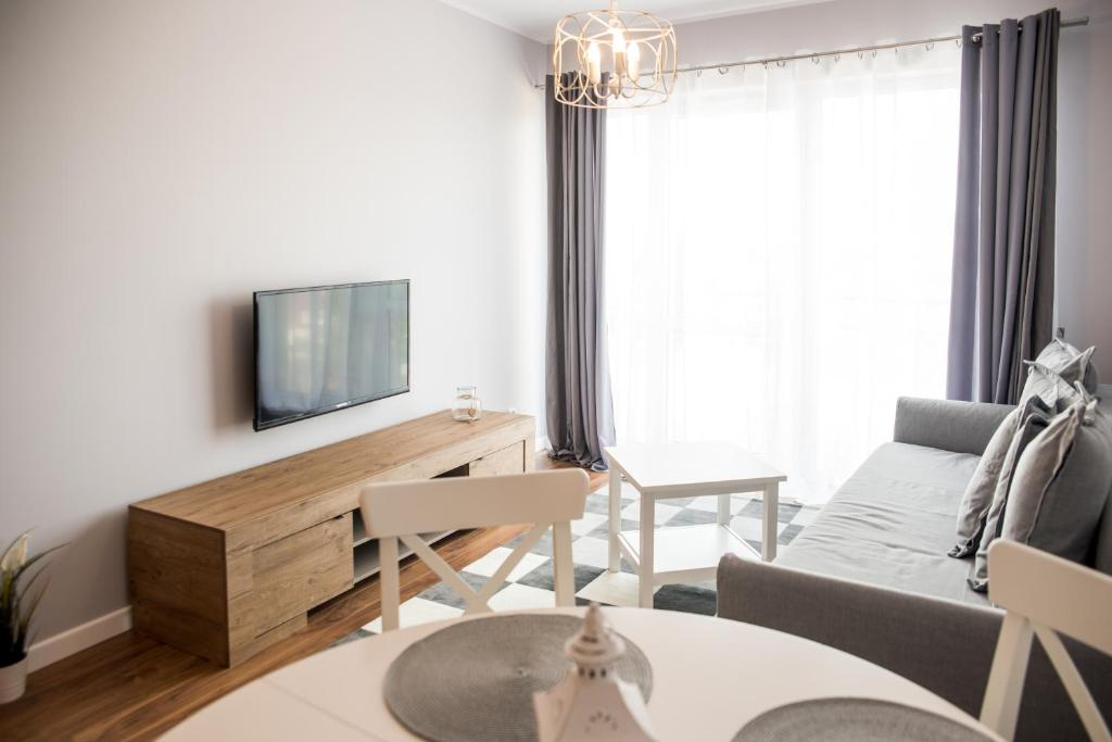 A television and/or entertainment center at Justan Apartamenty