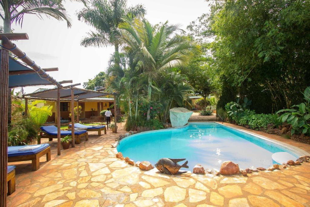 The swimming pool at or near 2 Friends JINJA Guesthouse