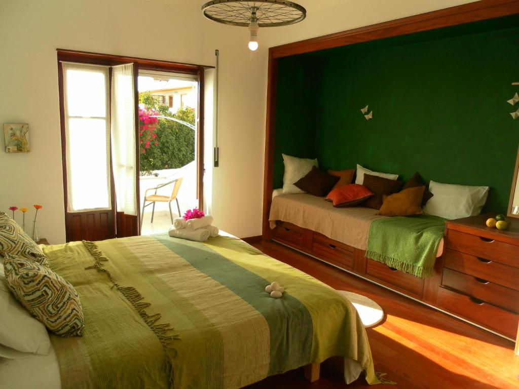A bed or beds in a room at Lemon Tree Hostel