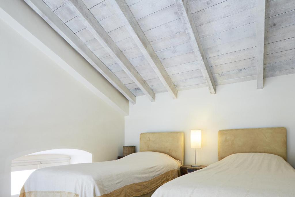מיטה או מיטות בחדר ב-Guesthouse Lila