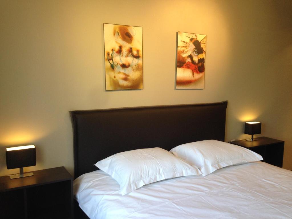 Un ou plusieurs lits dans un hébergement de l'établissement Comfort Aan Zee Penthouse