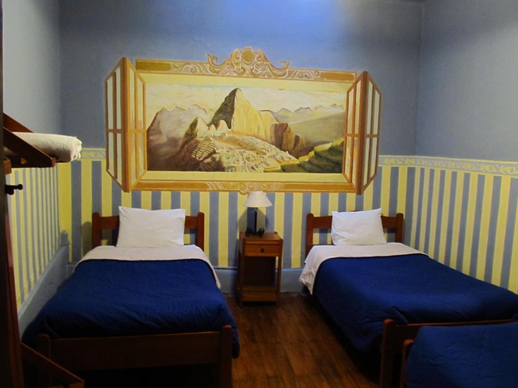 Cama o camas de una habitación en Hospedaje Turistico Recoleta