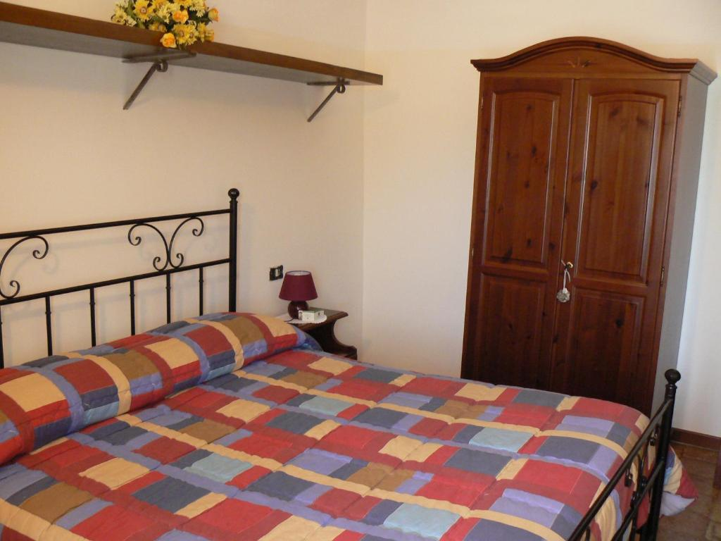 A bed or beds in a room at Residence Il Palazzo