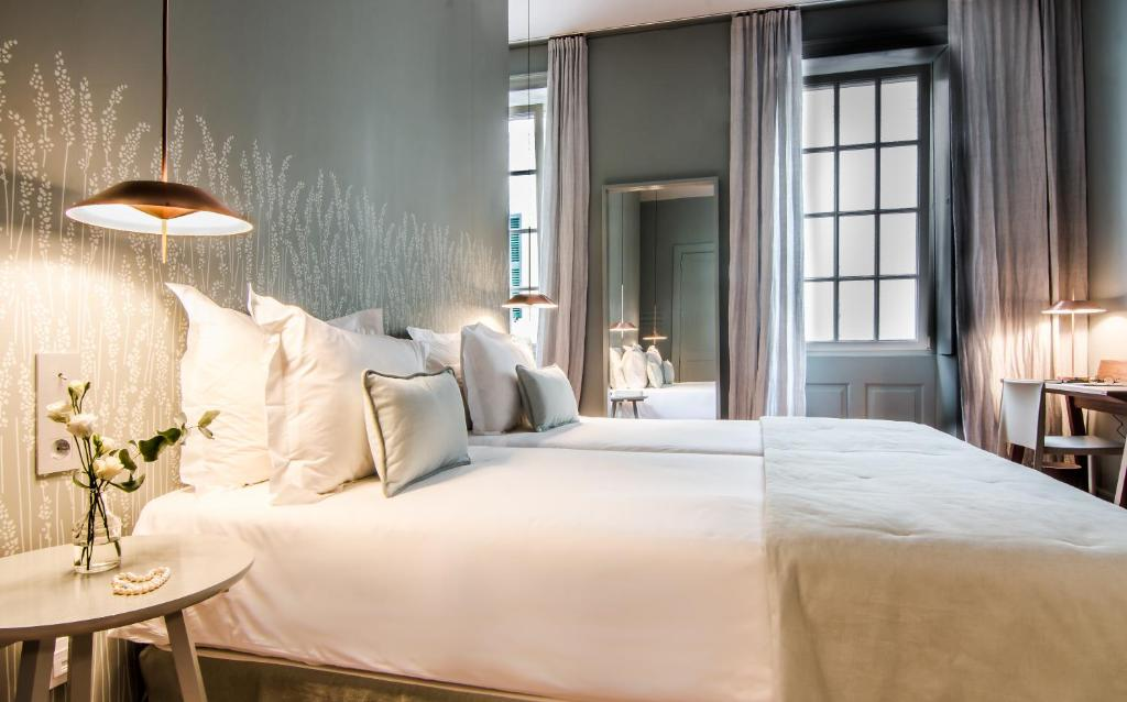 A bed or beds in a room at Casa Ládico - Hotel Boutique (Adults Only)