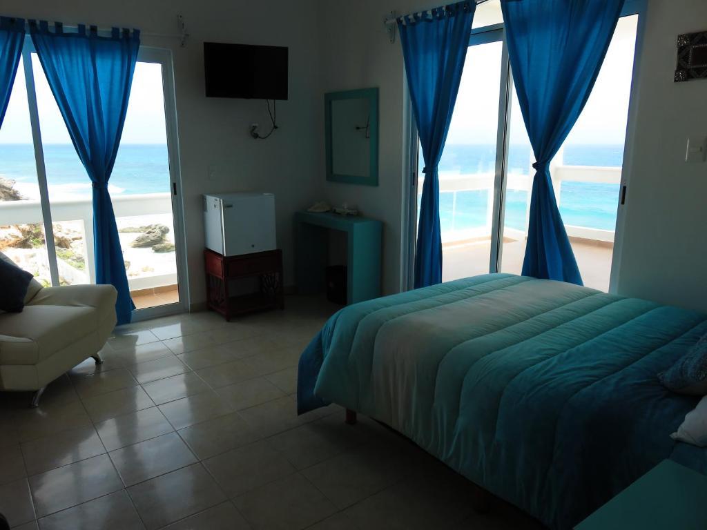 Cama o camas de una habitación en Casa Cural y Galería Isla Mujeres