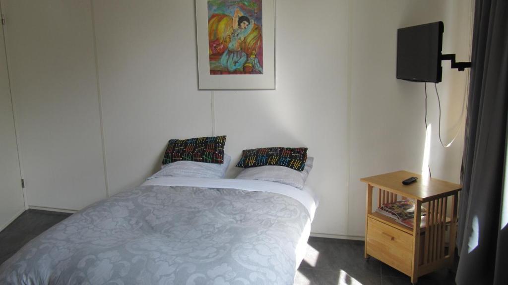 Ein Bett oder Betten in einem Zimmer der Unterkunft Excellent Rooms Amsterdam