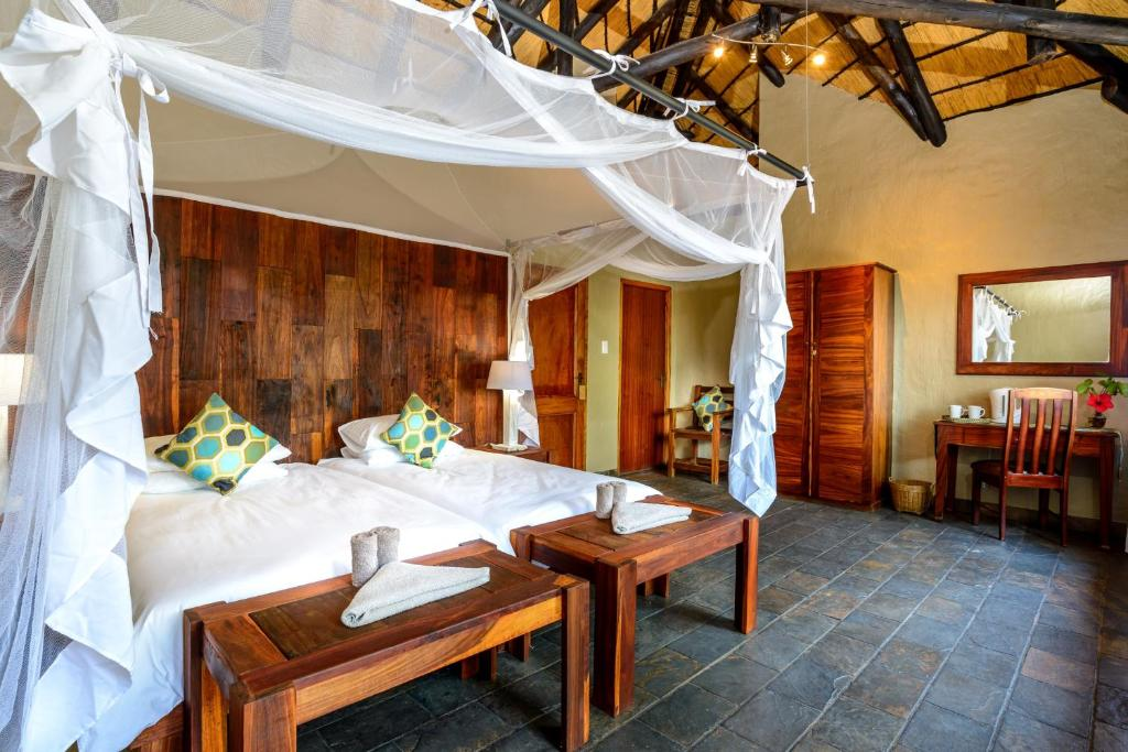 A bed or beds in a room at Gondwana Namushasha River Lodge