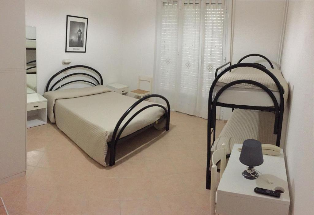 A bed or beds in a room at Hotel Riz