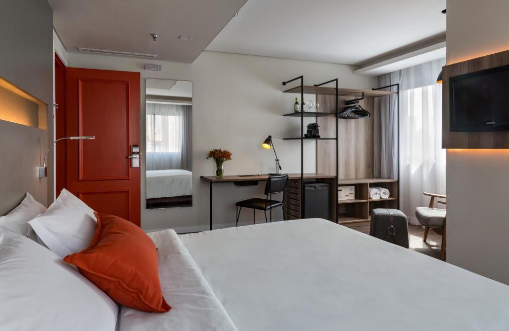 Cama ou camas em um quarto em Intercity São Paulo Ibirapuera