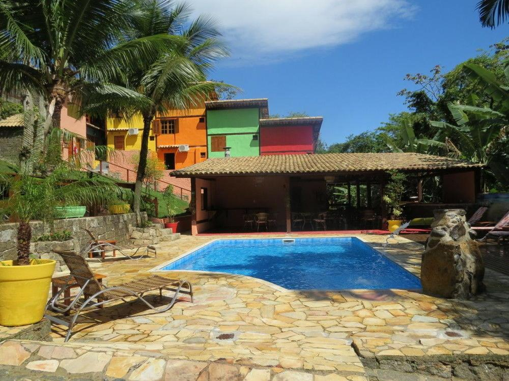 The swimming pool at or near Lua Azul Pousada