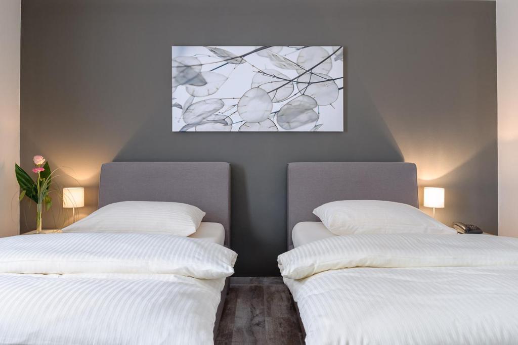 Ein Bett oder Betten in einem Zimmer der Unterkunft sleepIN