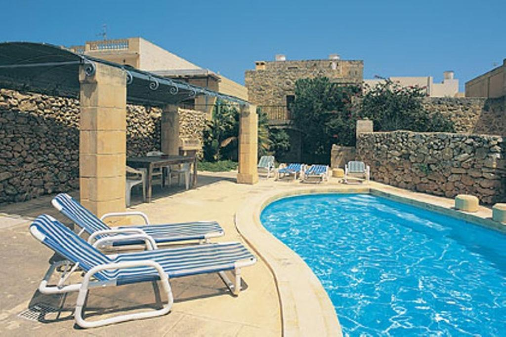 "The swimming pool at or near ""Steves Villas"" Villa ta Rosi"