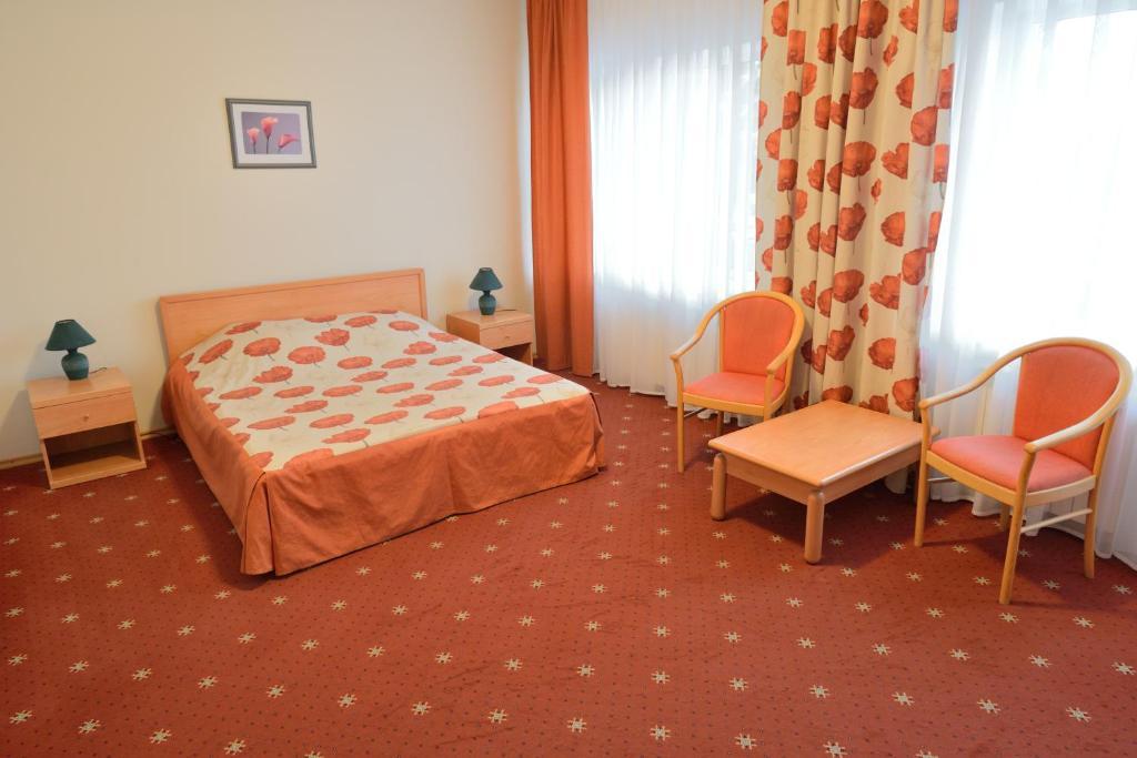 Кровать или кровати в номере Центр Кстово