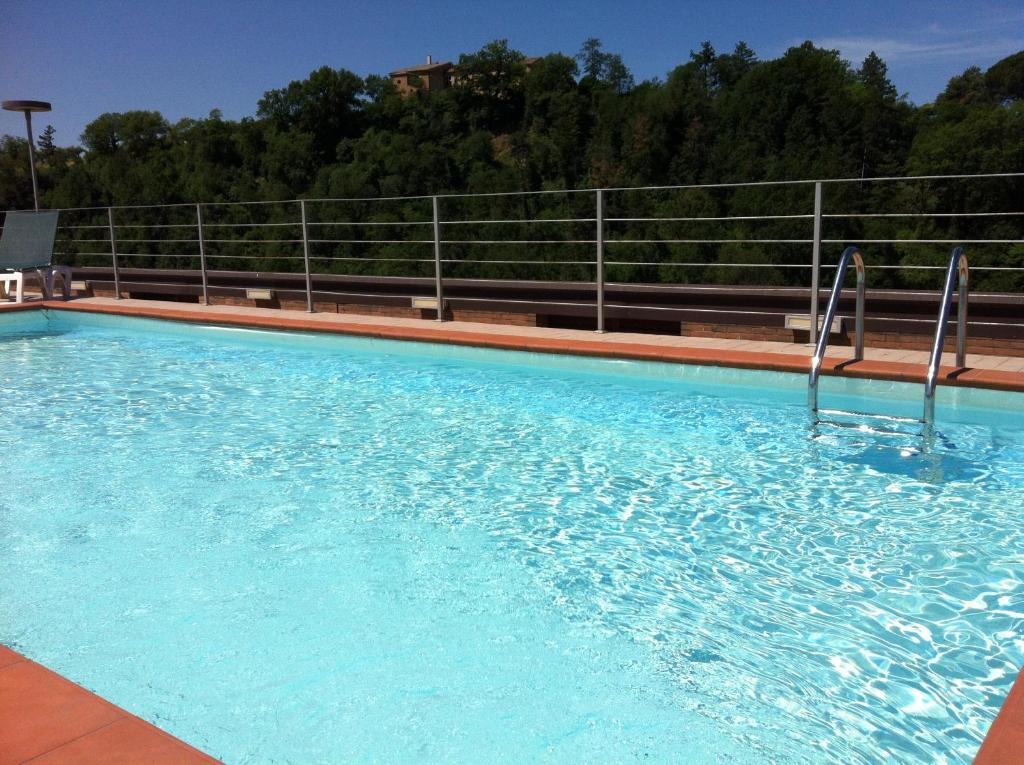 The swimming pool at or near Hotel Giò Wine e Jazz Area