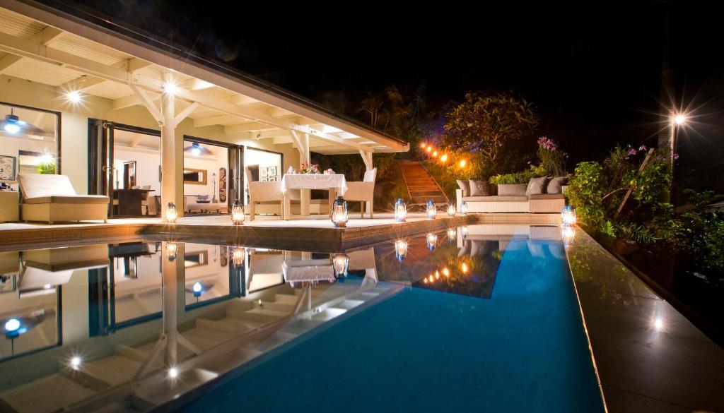 The swimming pool at or near Taveuni Palms Resort