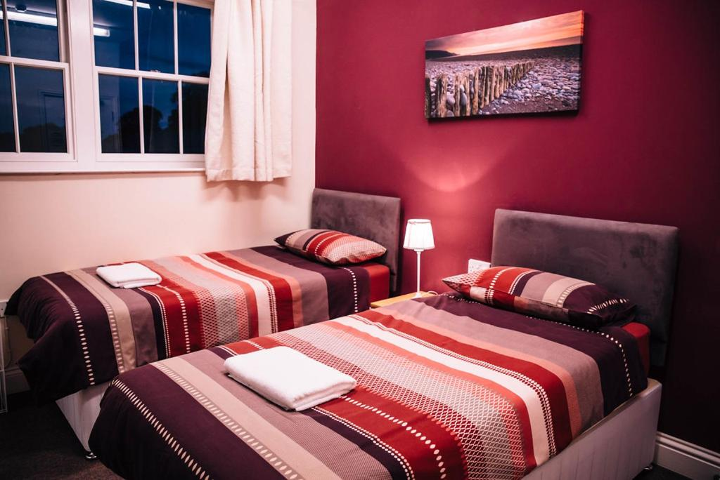A bed or beds in a room at Jersey Accommodation and Activity Centre