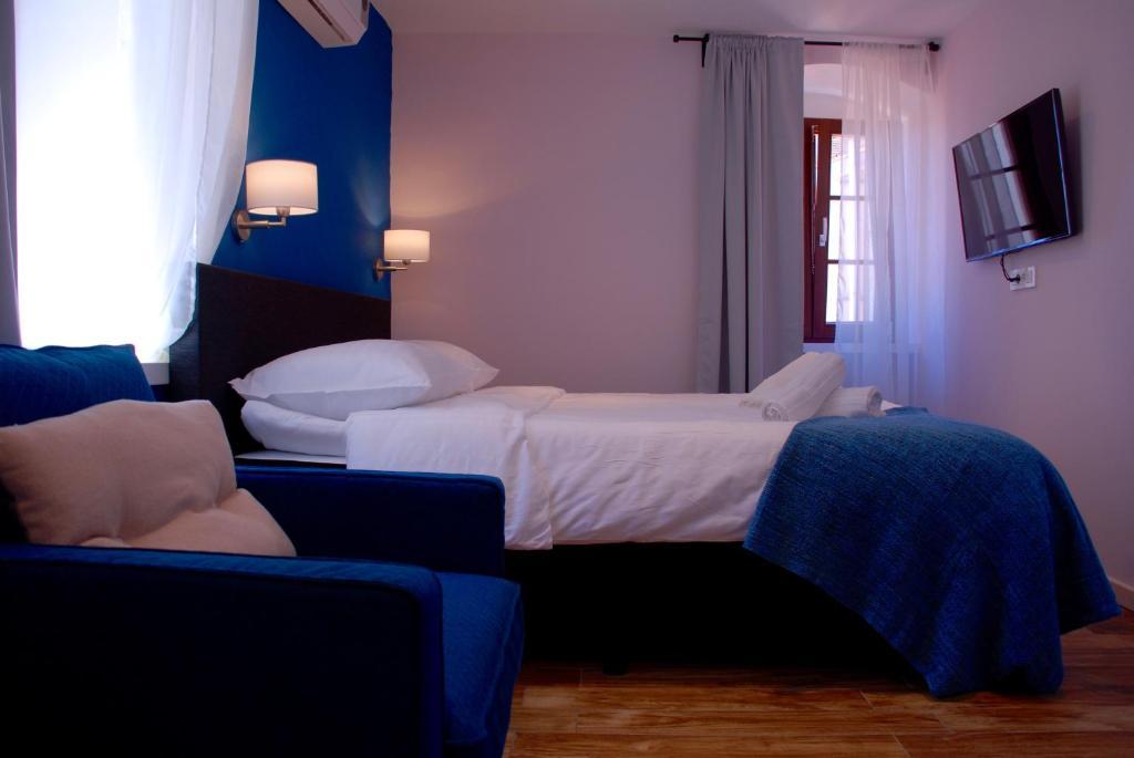 Ein Bett oder Betten in einem Zimmer der Unterkunft Old Town Inn