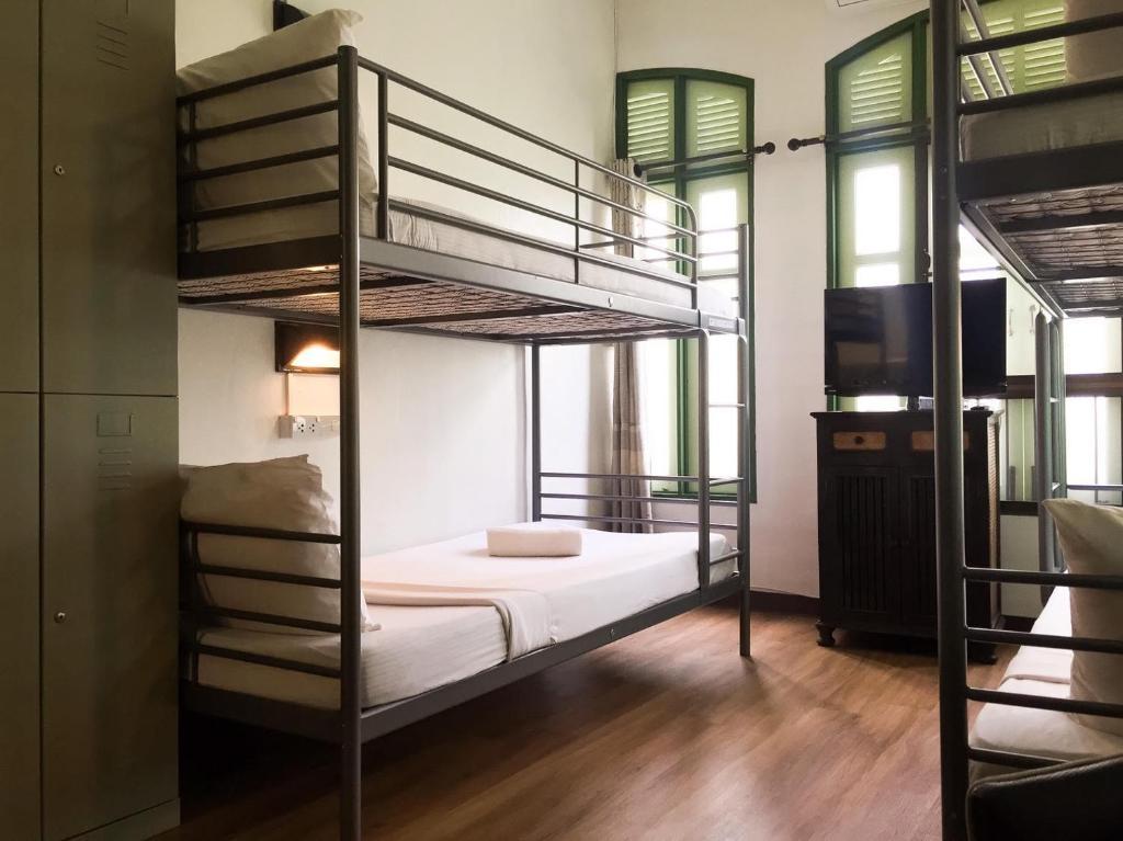 เตียงสองชั้นในห้องที่ บ้านเส-ลา เกสต์เฮ้าส์
