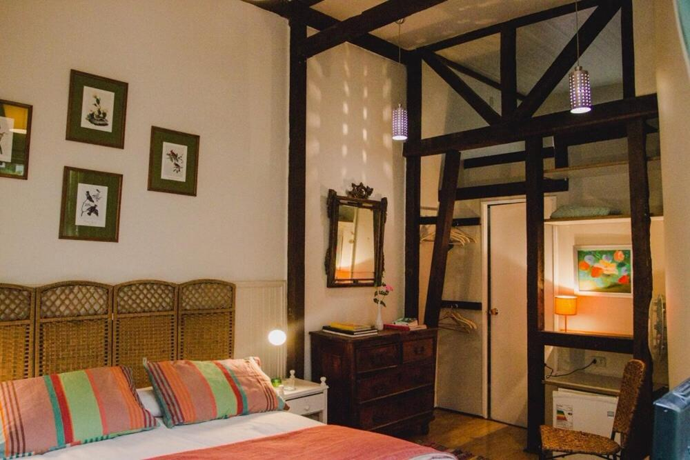 A bed or beds in a room at Patio Yungay