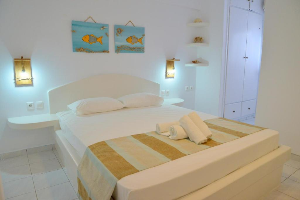 A bed or beds in a room at Corali Hotel