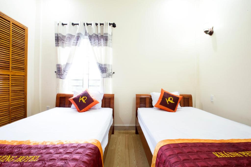 A bed or beds in a room at Khanh Phuong Hotel