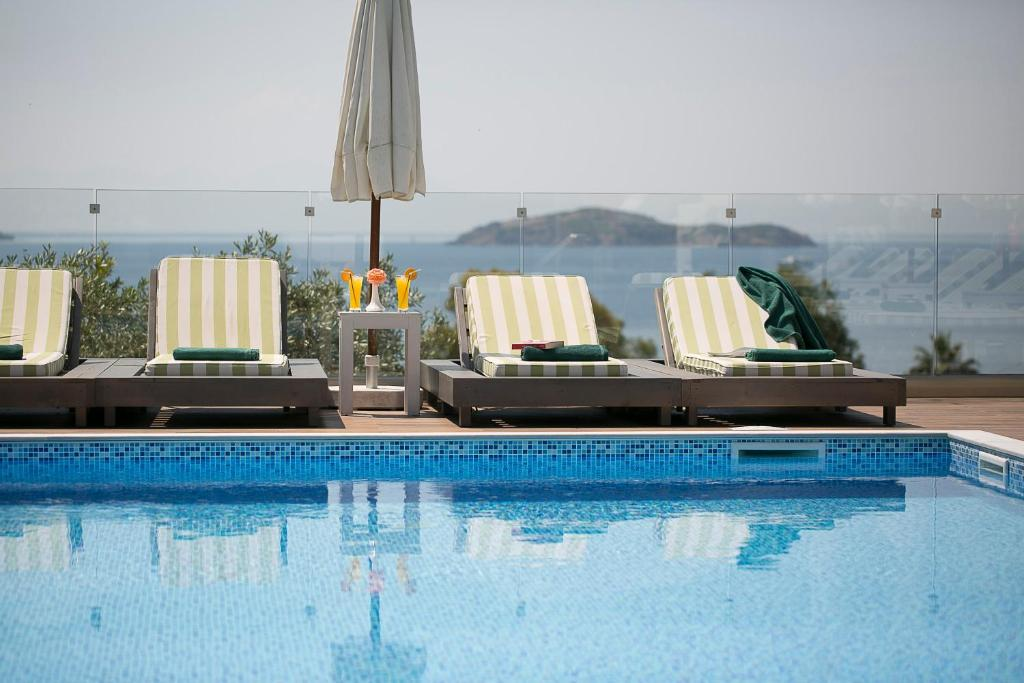 The swimming pool at or near Irida Aegean View-Philian Hotels and Resorts