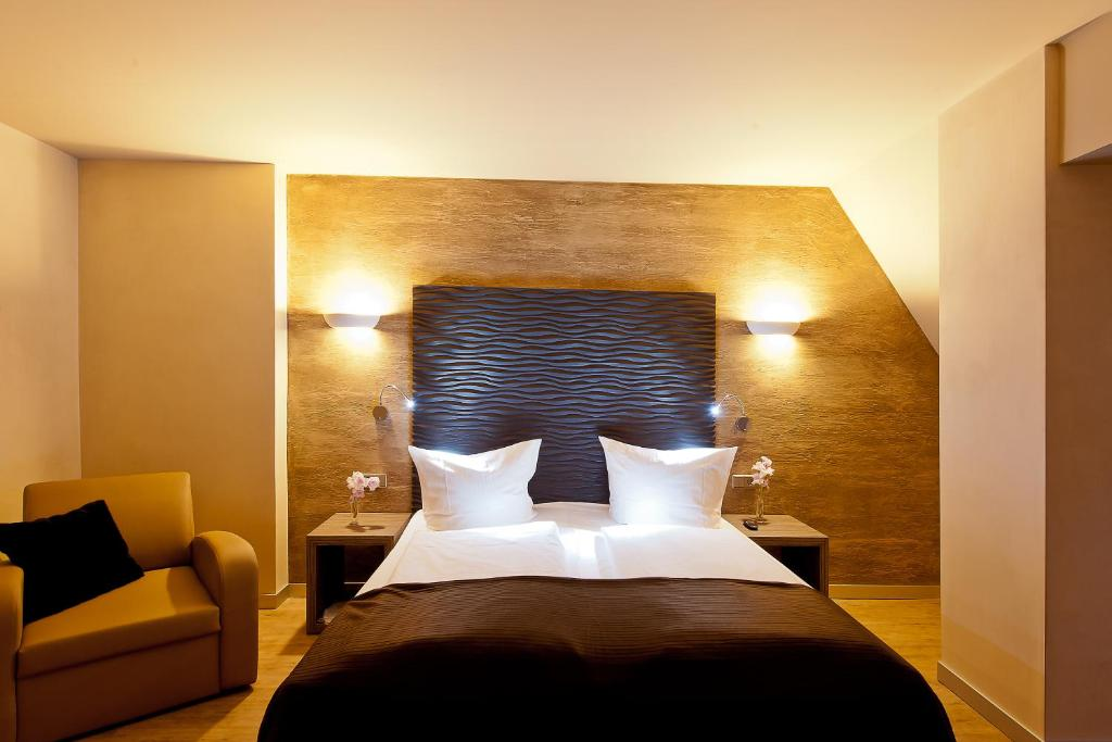 A bed or beds in a room at Artim Hotel