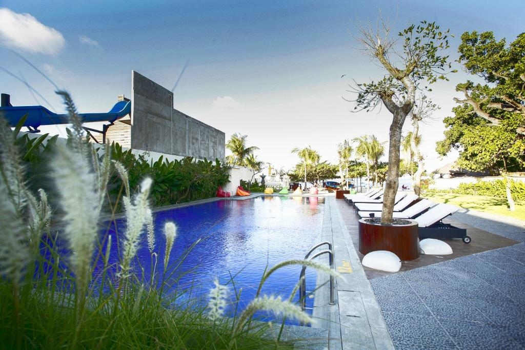 The swimming pool at or close to Benoa Sea Suites and Villas by Premier Hospitality Asia