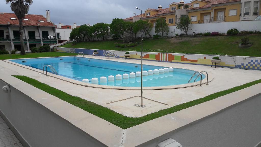 The swimming pool at or near Apartamento Verde Pino