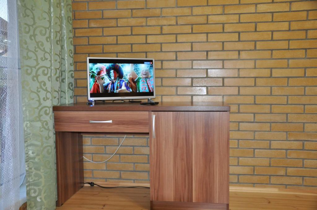 A television and/or entertainment center at Lesnoy Guest House