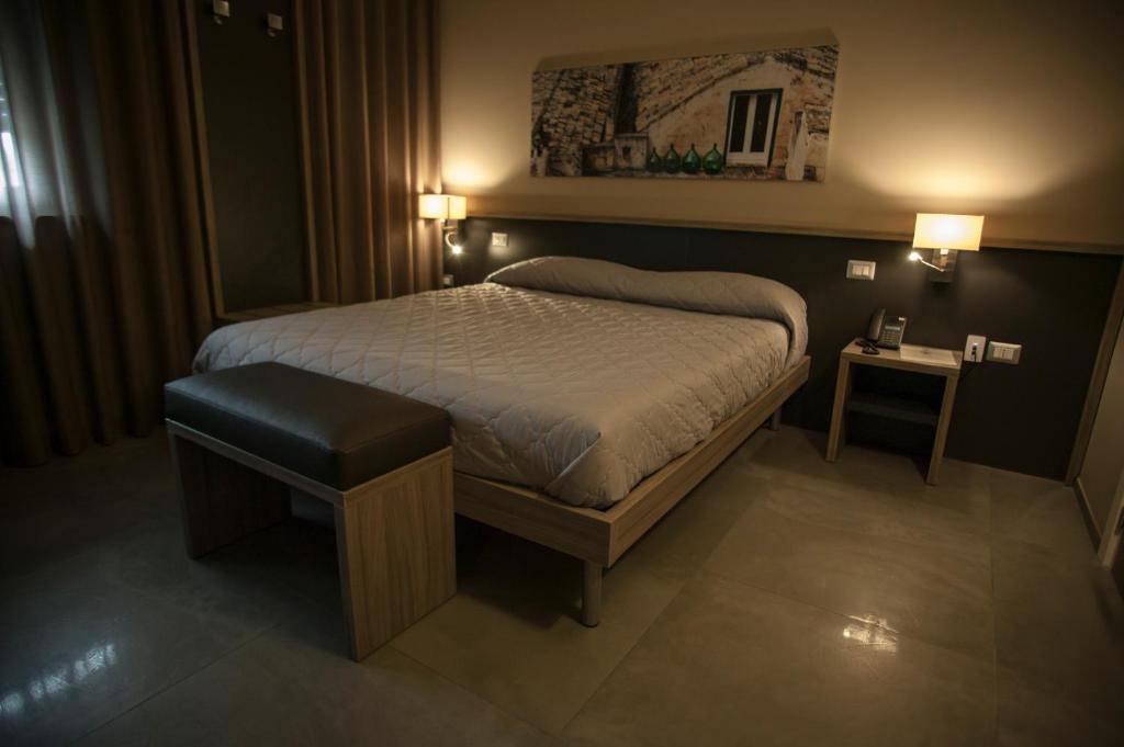 Letto o letti in una camera di La Sosta Motel
