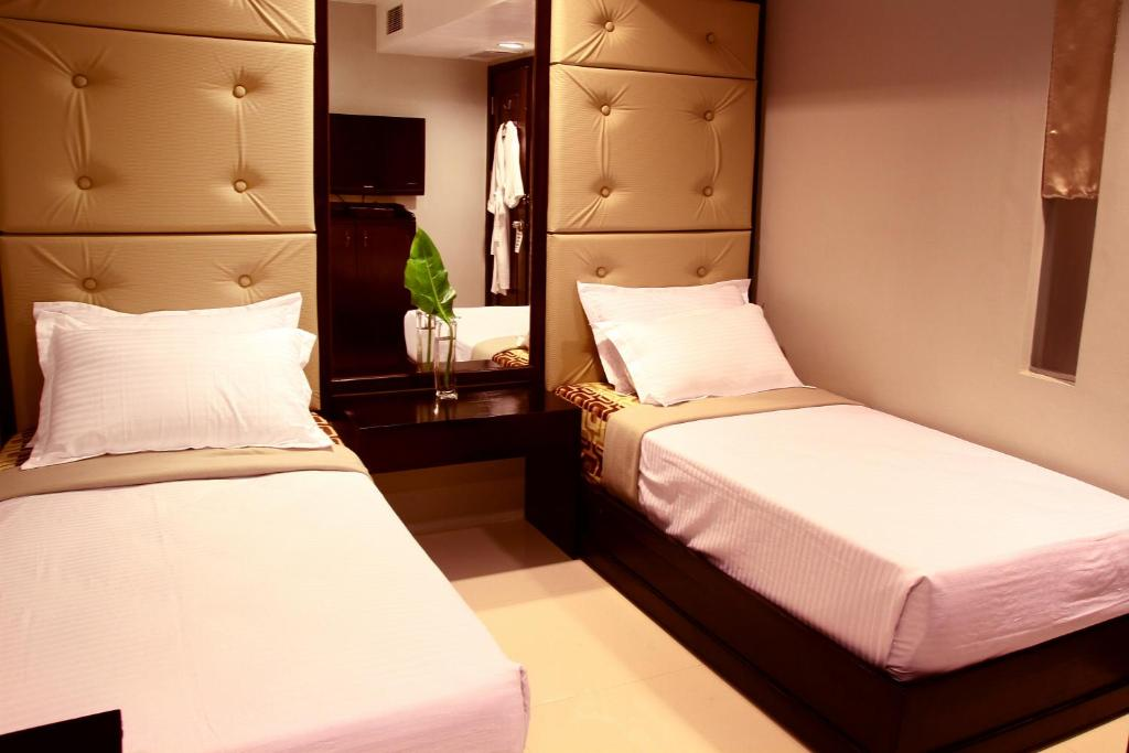 A bed or beds in a room at Travelers Pod