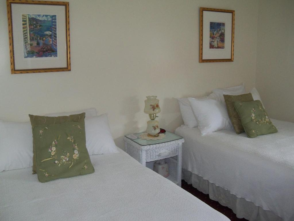 A bed or beds in a room at Holly Beach Hotel