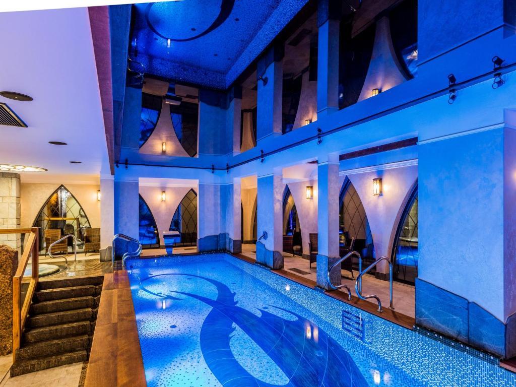 The swimming pool at or near Norweska Dolina Luxury Resort