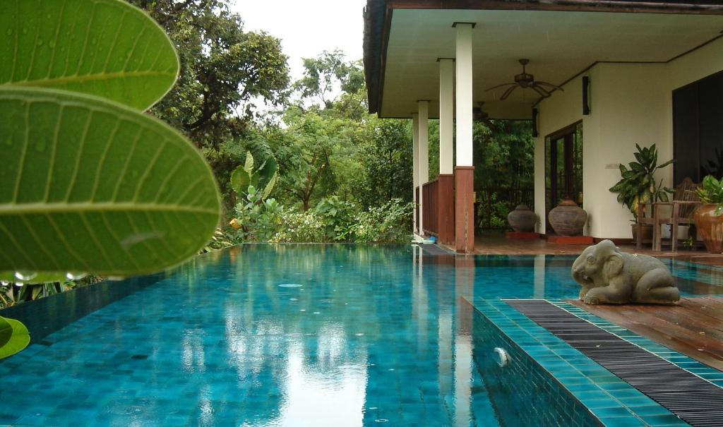The swimming pool at or near Gecko Villa