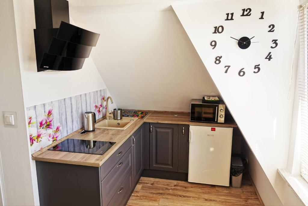 A kitchen or kitchenette at Przy Mickiewicza