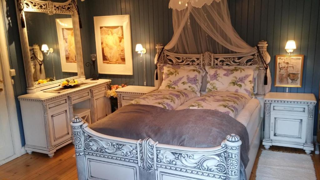 En eller flere senger på et rom på Solheim Accommodation