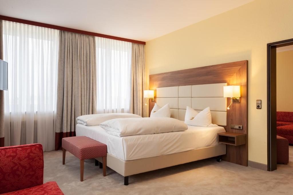 Ein Bett oder Betten in einem Zimmer der Unterkunft Hotel Augusta