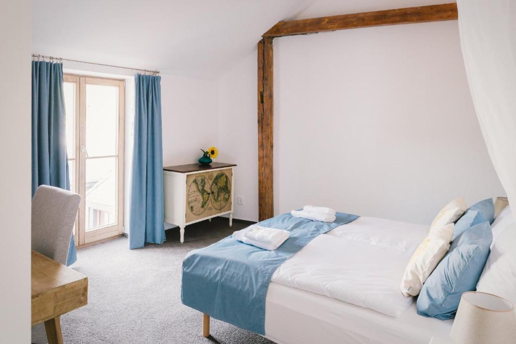 Postel nebo postele na pokoji v ubytování Nebespán